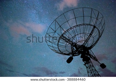 huge radar system in colorful sky