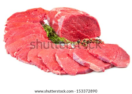 huge red meat chunk and steak isolated over white background  - stock photo