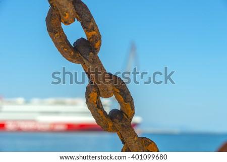 Huge rusty chain links. - stock photo