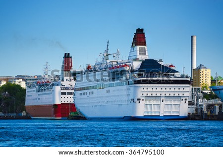 Huge sea cruise ferry in the Stockholm port, transport vacation background - stock photo