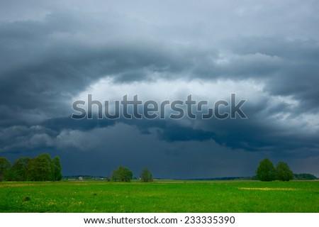 Huge shelf cloud approaching, dramatic sky - stock photo
