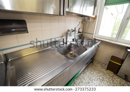 huge sink stainless steel industrial kitchen with open tap