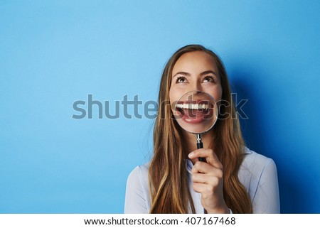 Huge smile on young brunette woman, studio - stock photo