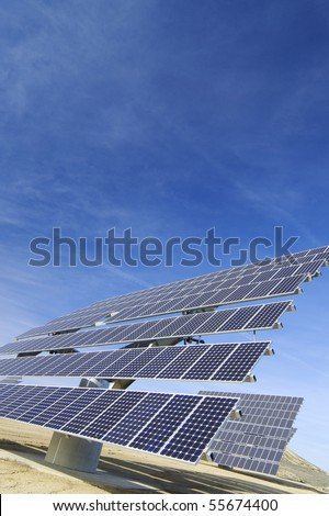 huge solar panels and blue sky with clouds - stock photo