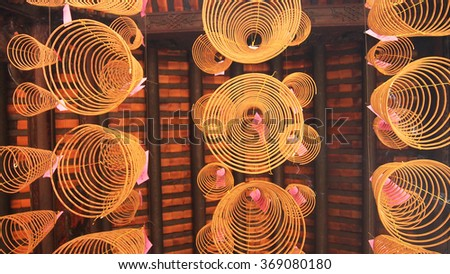 Huge Spiral Incenses hanging from the ceiling - stock photo