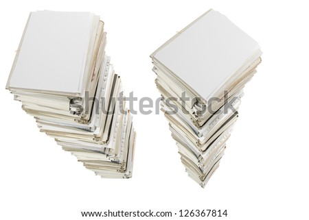 Huge stacks of documents isolated on white