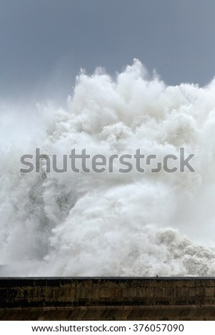 Huge stormy sea wave over pier, north of Portugal