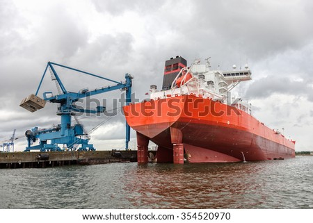 Huge tanker ship moored to a wharf. - stock photo