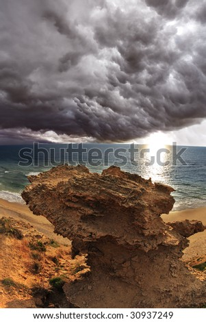 Huge thundercloud above Mediterranean sea. A sunset