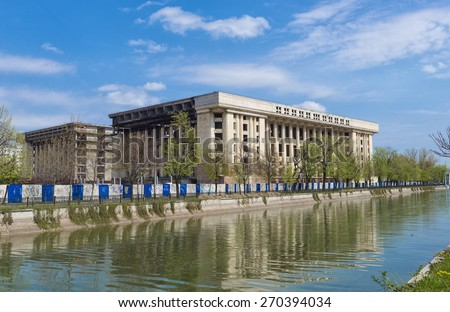 Huge unfinished Romanian building in Bucharest called Casa Radio, on the shore of the Dambovita River intended to serve as a museum of the Romanian Communist Party but never happend. - stock photo