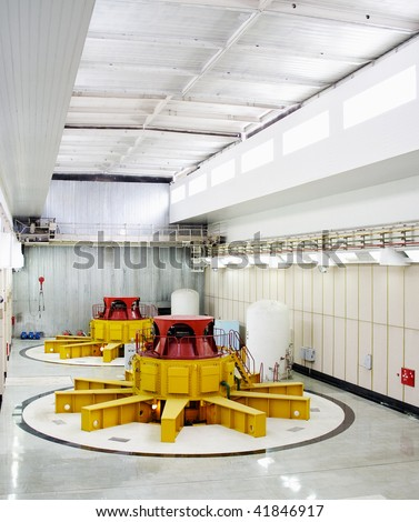 Huge water turbine generators. Hydroelectric powerplant. Interior - stock photo