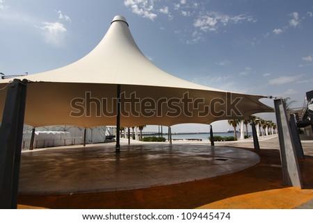 huge white tent as an umbrella - stock photo