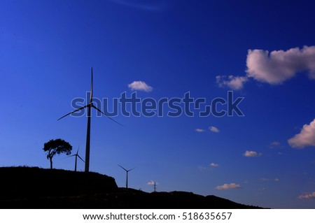 Huge windmill station with blue sky background