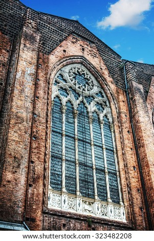 huge window in San Petronio cathedral side wall in Bologna, Italy - stock photo