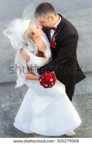 Hugging a young couple in love - stock photo