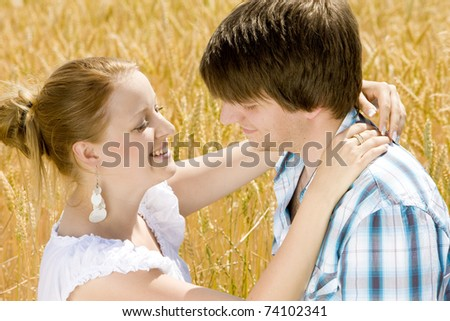 hugging couple's portrait - stock photo