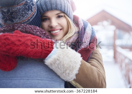 Hugging in winter day  - stock photo