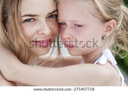 Hugging smiling mother and daughter. Family, child and happiness concept - stock photo