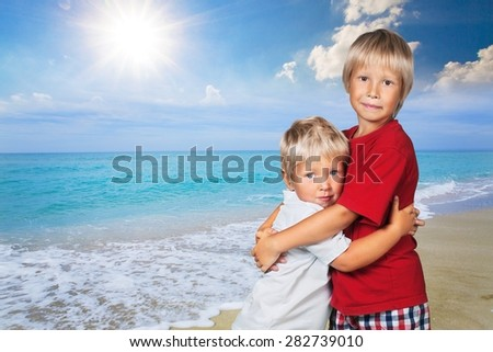 Hugging, son, tickling. - stock photo