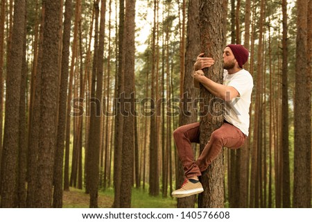 Hugging trees to support nature - stock photo