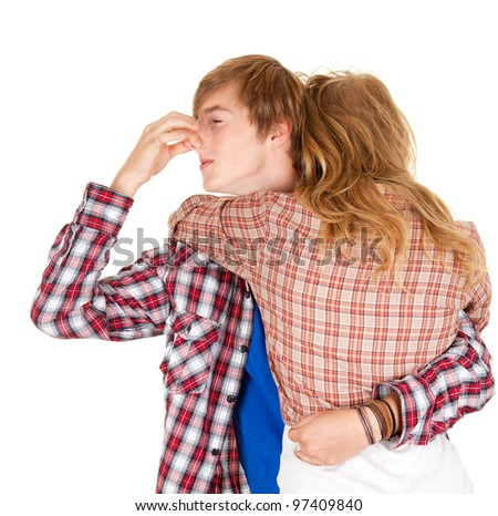 hugging woman and man, she smells hideously - stock photo