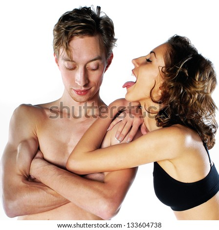 Hugging young couple - stock photo