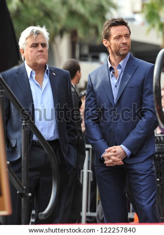 Hugh Jackman & Jay Leno (left) on Hollywood Blvd where Jackman was honored with the 2,487th star on the Hollywood Walk of Fame. December 13, 2012  Los Angeles, CA Picture: Paul Smith - stock photo