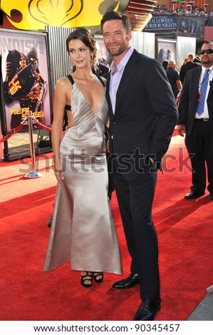 "Hugh Jackman & Olga Fonda at the Los Angeles premiere of their new movie ""Real Steel"" at Universal Studios Hollywood. October 2, 2011  Los Angeles, CA Picture: Paul Smith / Featureflash - stock photo"