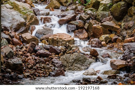 Huihang Ancient Trail Hiking Tour.  Image using slow shutter speed, waterfall and river in mountains between Anhui and Zhejiang, China