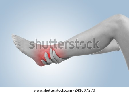 Human Ankle pain with an anatomy injury caused by sports accident or arthritis as a skeletal joint problem medical health care concept. - stock photo