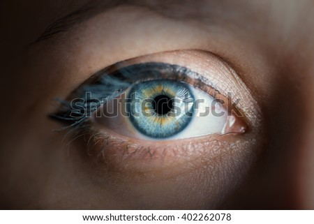 Human blue eye with reflection closeup. Color toned image. - stock photo