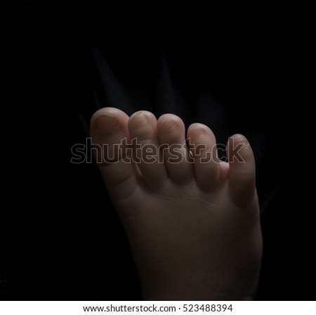 Human body parts toes and feet. Close up of mixed race baby Asian and British new born baby showing details and natural development of the human body.