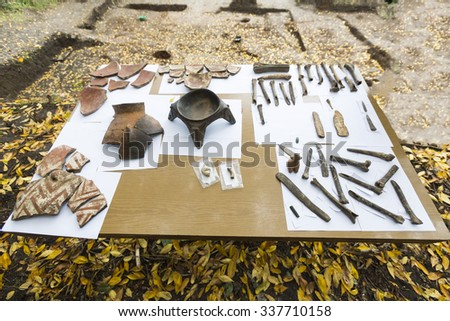 Human bones and pottery are shown on a table from archaeological excavions in Bulgaria. - stock photo