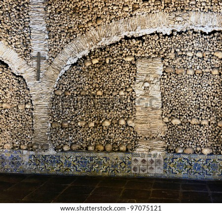 Human bones  and skulls in the Temple of the Bones in Evora - Alentejo, Portugal - stock photo