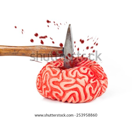 Human brain rubber with hammer blow and blood spill isolated on white background.