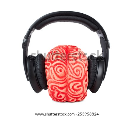 Human brain rubber with headphones on white background. - stock photo