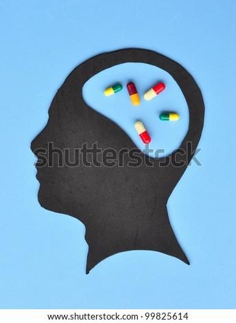 Human brain with pills - stock photo