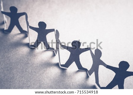 Human chain paper for teamwork concept