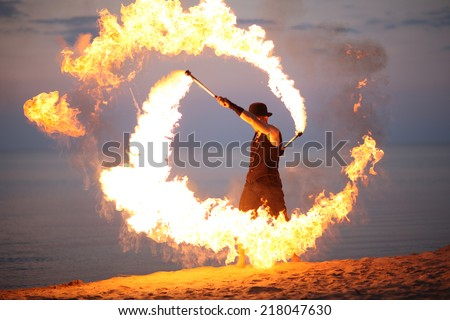 Human controlling fire; fire show - stock photo