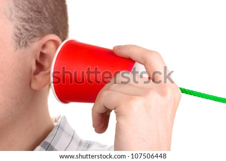 Human ear and paper cup near it close-up isolated on white - stock photo