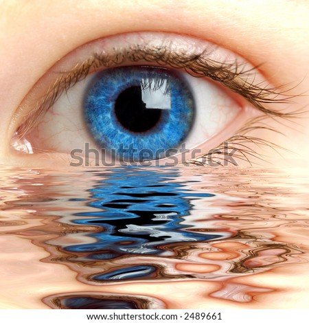 Human eye reflected in a surface of water - stock photo
