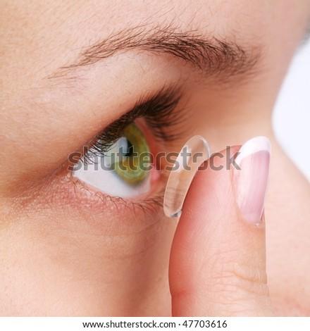 human eye with corrective lens on a white - stock photo