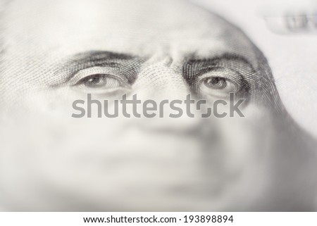 Human eyes. Fragment of 100 US dollars banknote. - stock photo