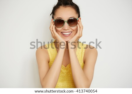 Human face expressions and emotions. Body language. Close up isolated shot of cute young female wearing stylish, woman with dark hair looking with happy smile at the camera on the white background  - stock photo