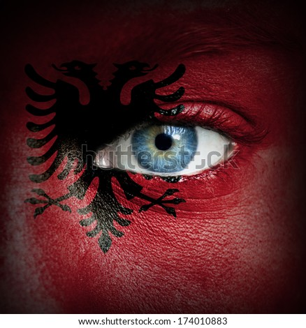 Human face painted with flag of Albania