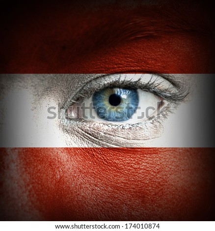 Human face painted with flag of Austria
