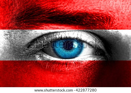 Human face painted with flag of Austria  - stock photo