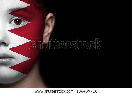 Human face painted with flag of Bahrain - stock photo
