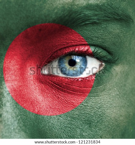Human face painted with flag of Bangladesh - stock photo