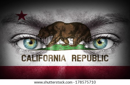 Human face painted with flag of California - stock photo